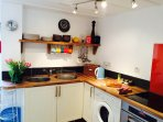 Bright country cottage kitchen through to private garden