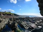 Children will love hunting for sea creatures on this beach, a gem of the south coast