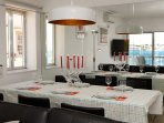 ...and a dining table for 6 pax where you can all enjoy the sea view