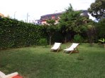 Beautiful garden with sun loungers for your comfort