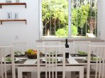 Dining table in the kitchen with garden view