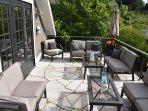 Private deck with sunbrella outdoor furniture.