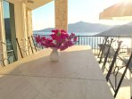 Outdoor dining table with its magnificient views of Kalkan Bay and sunset