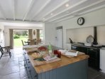 Working kitchen with 4 door aga, 2 electric ovens, 2 dishwashers and large american  fridge freezer
