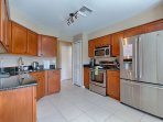 Fully equipped Kitchen with breakfast nook that over looks the pool area and Orange Groves