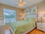 Queen Bedroom with SMART TV that overlooks the pool area and Orange Groves