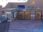 Built in natural gas BBQ, burner, sink and even a small fridge for your outdoor cooking needs