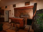 Great custom wet bar with special hand carved Mesa Verde diorama, sink and mini fridge