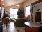 Living room- 60' TV  sound bar/subwoofer, sofa sleeper, loveseat bigger than looks Moab Rim views