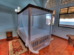 Tranquil bedroom of casita & windows that open up right to the fresh sea air.