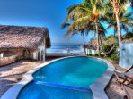Pool & hangout with custom grill, hammocks  & coconut trees area steps above the private beach.