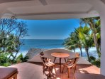 Hangout area w/ lounge chairs, 2nd dining table & amazing views on bottom floor of villa.