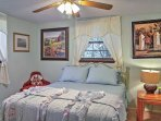 Master bedroom w/queen bed and TV