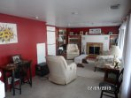 Family room on lower level.   TV with Direct TV, wood-burning fireplace.  Pull out bed in closet.