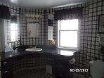 Main floor bath.  Combination tub/shower.  Linens & paper products provided.