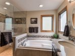 Master bath jetted tub Double shower with bench