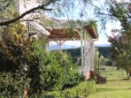Relax on the wide verandas overlooking the farm to the Comboyne mountains
