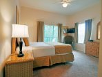Queen bedroom with own TV and access to private balcony