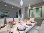 fully equipped kitchen with dining and living area and exit to the pool