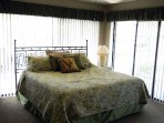Airy master bedroom with king bed.
