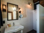 The shower room has it's own rain shower, shaving mirror and luxurious toiletries and towels.