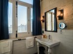 The funky Victorian Vanity compliments the modern Industrial feel highlighted with Edison Bulbs.