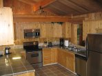 Cedar kitchen with granite countertops and Stainless Steel Appliances. There is also a 2nd kitchen.