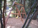 Swing set on the 5 acre property in the forest.