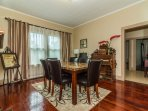 The rustic cherry wood floors compliment  historical design of the dining room