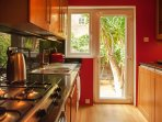 Fully equipped kitchen leads to your own private garden
