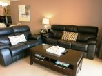 Comfortable leather full-size sofa-bed in living area