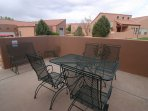 Patio table seats 6 plus 2 extra chairs and a love seat glider to enjoy rim view