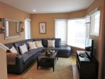 Middle Floor Living area with wrap around soft leather sofa and television.
