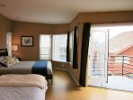 Top floor master with 1 king bed, 2 twin beds and 2 balconies