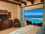 One of the villa bedrooms overlooking the private infinity pool and the Pacific