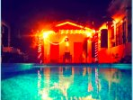 Beautiful photo of the courtyard pool area at night, take an evening swim following by stargazing!