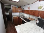 Galley with cooktop, microwave, coffee maker, toaster, blender, etc.