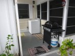 Back porch with tool shed, washer, and BBQ