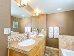 Upstairs 'master' bathroom w/ beautiful double-wide sink vanity and plenty of storage underneath.