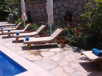 Sunbathing area and poolside plantings