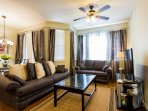 Living Room equipped with ceiling fan, sofa bed, 42' HD TV and PS3 game system