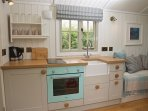 Kithchen with oven grill, hob, fridge, kettle and toaster plus everything you need.
