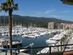 Views from balcony, with the marina and the foothills of the Pyrenees
