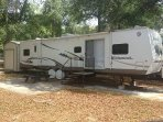 40ft Travel Trailer with Golf Cart Included