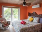 Suite Papaya King Bed with deck above the Pool