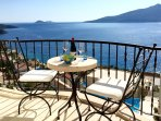 A glass of wine on the top terrace enjoying the enchanting views over Kalkan bay.