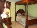 Impressive queen-size canopy Tempur-pedic bed and queen-size leather Tempur-pedic sofa-bed in the se