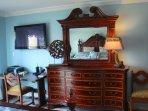 Master bedroom with flatscreen TV and an abundance of closet space.