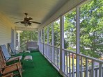 Relax on the porch while you gaze out at the serene lake.