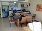 Spacious dining area with open fully equipped modern kitchen